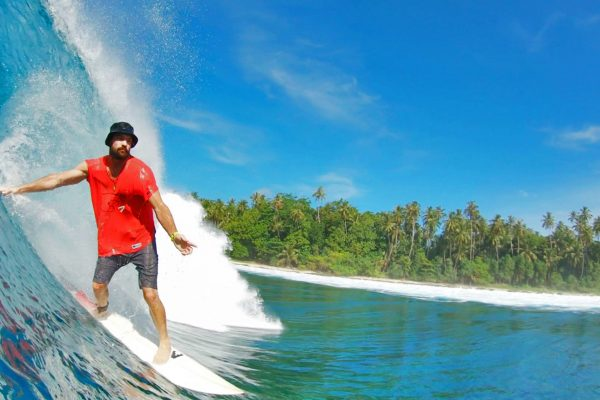 Man surfing Simeulue Island North Sumatra
