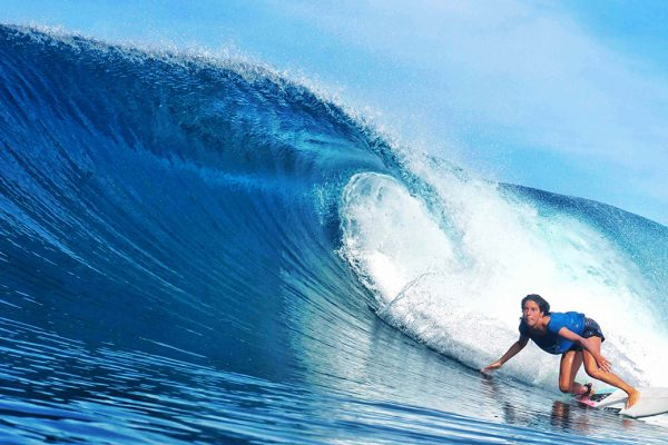 Surfing Girl on best surfspot of Simeulue Island