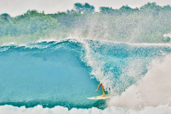 Man surfing during surf trip Simeulue Island