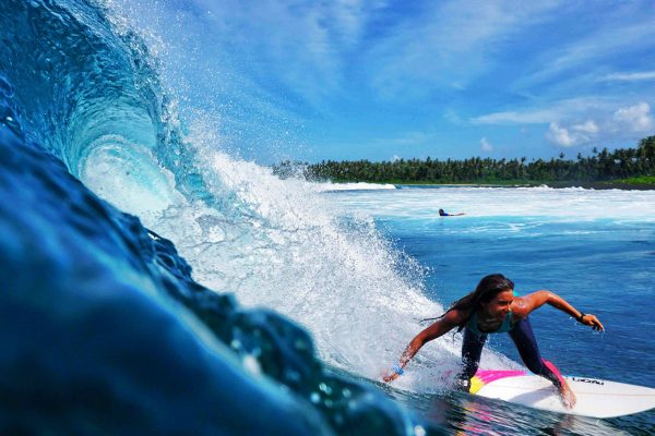 Girl Surfing During Surfcamp Simeulue Island